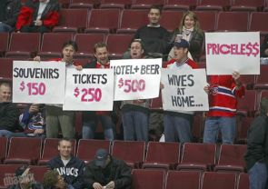 fans-holding-signs-at-game-priceless