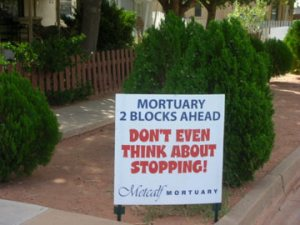 mortuary-ahead-marathon-sign