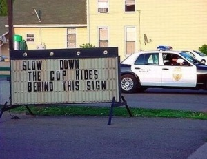 slow-down-cop-car-sign